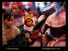 VIETNAM (BoazImages) Tags: world travel portrait baby flower art face women pretty dress faces market traditional border culture documentary vietnam tradition yunnan miao minority hmong locations indigenous embrodery bacha boazimages