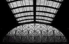 Juxtaposition (Aaron Yeoman) Tags: uk greatbritain roof light england blackandwhite bw london window glass station train iron sony curves perspective rail railway railwaystation trainstation gb paddington ironwork a200 firstgreatwestern paddingtonstation brunel glasswindow isambardkingdombrunel straightlines greatwesternrailway blackwhitephotos platinumphoto sonya200