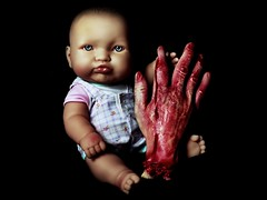 the hand that feeds (mugley) Tags: portrait baby colour cute 120 mamiya film mediumformat studio toy prime kid blood 645 infant doll fuji zombie fingers sb600 evil creepy negative horror stare epson disturbing bleeding 6x45 reala mamiya645 cannibal c41 reala100 v700 severedhand offcameraflash mamiya645protl m645 remotetrigger brollybox fujicolorsuperiareala100 80mmf19sekorc blazzeomegtrigslt4
