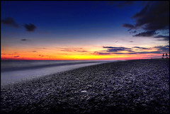 ...summer on a solitary beach... (zio.paperino) Tags: longexposure sunset red sea summer vacation italy sun holiday color sol beach nature water yellow stone geotagged atardecer soleil nikon europe italia tramonto mare sonnenuntergang angle blu wide coucher playa natura tokina explore sole puesta sonne frontpage ocaso calabria hdr catanzaro 1224 lamezia naturesfinest d90 ziopaperino mygearandme mygearandmepremium mygearandmesilver mygearandmegold