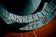Step Up (justingreen19) Tags: new york nyc light shadow ny newyork building up metal skyscraper canon stand rust iron view manhattan letters rusty sigma plate wideangle dirt binoculars step font type lettering rockefeller curve 1020mm vignette crusty embossed typeface capitals lightroom accessibility lowepro rockefellerbinoculars loweproukcompetition