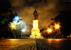 Shadows of Cloudy Night - Sombras de Noche Nubosa (Onironauta...) Tags: plaza argentina statue vanishingpoint buenosaires shadows nightshot buenos aires monumento cinematic puntodefuga adrogue strangeskies cloudynight guillermobrown almirantebrown sandrog onironauta platinumheartaward shadowsofthenight plazabrown franciscocafferatta sombrasdelanoche