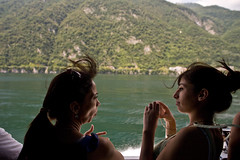 Mother and daughter (reposted) (Gary Kinsman) Tags: camera italy lake como hair point lago italia wind turquoise candid hill profile daughter mother canon5d moment lombardia 2009 lombardy sigma2470mmf28