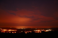 (Roanne Lucy Silver) Tags: lighting light sunset red orange black silhouette yellow clouds canon silver eos lights countryside town glow roanne urbanlights 1000d canoneos1000d