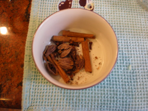 The whole spices: black cardamon, cinnamon, and cloves