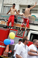 Firetruck boys (Lauren Barkume) Tags: africa street gay red 2 shirtless portrait people 3 men lesbian southafrica march dance dancing bare chest crowd profile oct pride parade firetruck pack 09 firemen six queer abs 2009 3rd johannesburg baloons joburg gblt jhb jozi zoolake lgbti laurenbarkume