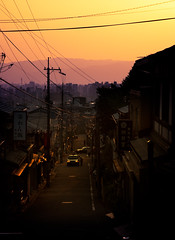 TD: The Dark Side Of Kyoto (rasenkantenstein) Tags: street city travel houses light sunset shadow people urban sun house mountain man mountains color colour men art cars colors car yellow japan set composition contrast landscape photography japanese lights evening town wire kyoto colours purple shot deep cable cables wires valley late prefecture depth streetshot shadw rasenkantenstein travlogue