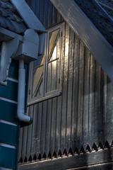 Sunlight reflections (Bas Lammers) Tags: blue roof sunlight white house black reflection window netherlands dutch canon daylight wooden paint village 1022mm hdr marken ijsselmeer volendam 50d markerwaard