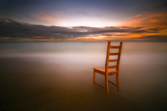 Juxtapositionally Speaking (dan barron photography - landscape work) Tags: longexposure sunset seascape colour clouds chair waves web juxtaposition