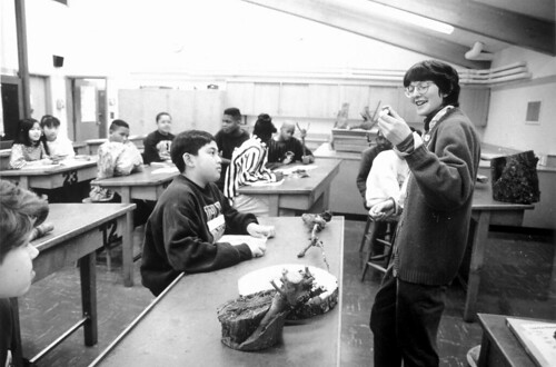 Teacher and students in classroom, circa 1990s
