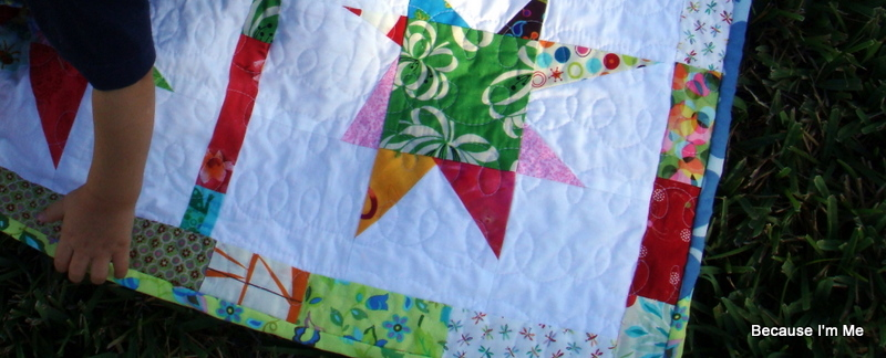 star quilt with adorable baby hand  :)