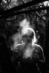 companion piece (margolove) Tags: blackandwhite sun mist cold girl hat fog oregon canon dark portland 50mm branches breath fingers hedge mysterious pdx backlit 18 beanie digitalrebel bushes tangle xsi