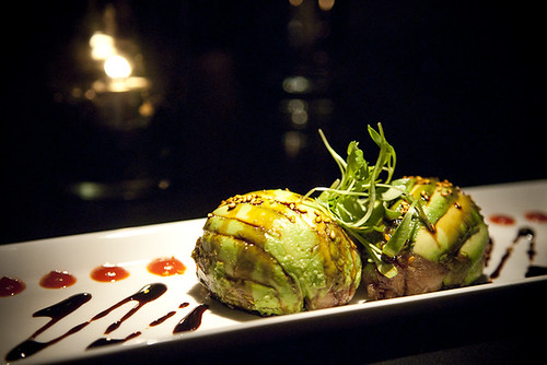 Dinosaur Egg - Diced albacore tossed in unagi sauce, encased in avocado shell, topped with sesame seeds