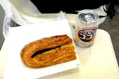 A chocolate danish, hot milk cocoa