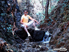 Senaid sitting at small waterfall (Ajan Alen) Tags: trees mountain guy green nature wet water sunglasses yellow river flow waterfall rocks sitting bosnia gray tshirt structure sneakers panasonic foliage herzegovina shorts flowing slap dmc skakavac alen fz7 ajan ozimica senaid