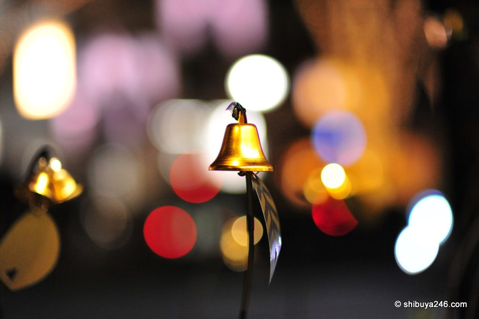 Tiny bells and the lights from the road behind.