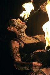 Insectavora: Fire Inside (Linus Gelber) Tags: nyc woman newyork girl tattoo ink fire manhattan lowereastside performance flame feed pyro bodyart burlesque angelica sideshow fireeater fireeating slipperroom tribaltattoo insectavora canon28135mmisusm feedbenefit