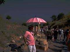 He wore pink (peggyhr) Tags: pink sunlight stone turkey ruins shadows pinkshirt ephesus historicalsite tourguide pinkumbrella mywinners globalvillage2 peggyhr impinkagainstcancer pinkpanamahat 2768a pinkpanamahat
