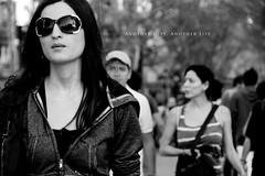 Another city, another life (yeryi) Tags: barcelona life street city portrait people blackandwhite bw woman blancoynegro sunglasses walking blackwhite calle nikon noir bokeh walk retrato candid bcn d70s ciudad 18200 blanc negre gafasdesol 18200mm