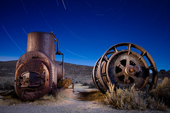 Bodie Boiler, Wheels, and Cogs (Ghost Town) (After Dark Photo) Tags: longexposure nightphotography lightpainting history abandoned mining fullmoon equipment ghosttown bodie wildwest boiler goldrush startrails easternsierranevada starcircles afterdarkphoto
