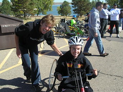 Flynn on the handcycle, with Claire from Craig Hospital