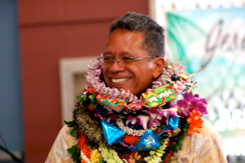 Pastor Dennis with leis