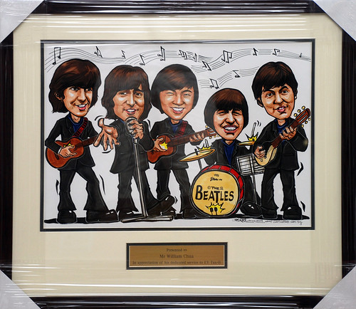 Beatles caricatures for Ernst & Young framed with metal engraving plate