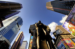 Standing Tall And Proud (RLJ Photography NYC) Tags: city newyorkcity blue man proud buildings view skyscrapers 42ndst timessquare tall manhatten 42ndstreet