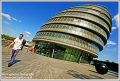 London City Hall   - Summer Stroll in Purple Trousers (david gutierrez [ www.davidgutierrez.co.uk ]) Tags: city greatbritain summer england urban holiday building london beautiful architecture clouds buildings wonderful spectacular geotagged photography hall photo arquitectura cityscape purple angle image unitedkingdom cityhall sony awesome centre perspective cities cityscapes bluesky center structure architectural explore 350 londres stunning excellent architektur trousers sensational metropolis alpha capture stroll frontpage londra impressive dt londoncity municipality edifice cites  f4556  1118mm londonsummer summerstrollinpurpletrousers sonyalphadt1118mmf4556 purpletrouser sony350dslra350