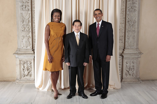 Obamas with the president of Vietnam