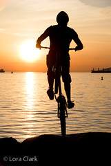 Bike Trials Sunset Silhouettes (loraclark) Tags: ocean sunset sun men beach water bike silhouette vancouver outdoors rocks ship britishcolumbia horizon shore cycle englishbay balance trials freighter mountianbike
