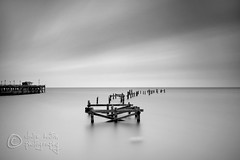 (Claire Hutton) Tags: old longexposure sea sky blackandwhite bw water clouds pier long exposure jetty smooth poles posts milky remains buoy slowshutterspeed ndfilter 10stop nd1000 nd110 bw110 leefilters