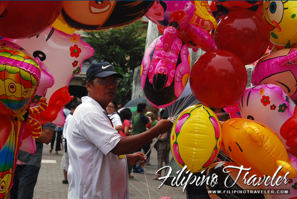 Man selling balloons