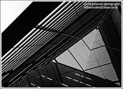 London Geometry in Black and White - More London Place (david gutierrez [ www.davidgutierrez.co.uk ]) Tags: blackandwhite morelondonplace geometry linesandcurves bw monochrome glass triangle noiretblanc monochromeaward blackdiamond black white wonderful awesome photo image sony dt 1118mm f4556 sonyalphadt1118mmf4556 sony350dslra350 cities cityscapes building buildings architectural photography metropolis centre center municipality structure edifice geotagged architektur spectacular impressive sensational londres londra b w artistic lines pattern 350 cites alpha architecture london cityscape urban arquitectura city
