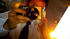 Flare (Josh Liba) Tags: camera leica portrait sun reflection guy me self work lens asian mirror warm tie cubicle panasonic sp flare gadgets selfie lx3 dmclx3 somethingiscoming joshliba