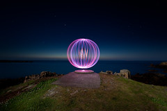 Plateau (Pikebubbles) Tags: ocean longexposure pink sea cliff lightpainting color colour colors circle colours purple orb round guernsey