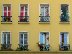 Windows of Paris (Storm Crypt) Tags: flowers houses windows plants paris france building tourism glass wall architecture french europa europe paint treasure hill perspective indoor montmartre structure explore pots condo pane hillside frontpage windowpane francais parisfrance finearts aparments ruemuller parisapartments garbongbisaya