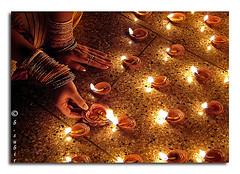Diwali (subirbasak) Tags: hand ritual lamps diwali puja subir depawali earthernlamps