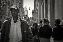 HEAT RAY (joewig) Tags: city people urban male interestingness streetphotography midtown cap stare blackman panasonicdmcg1