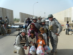 Unselfish Soldier: Aiirmen  with Iraqi Children