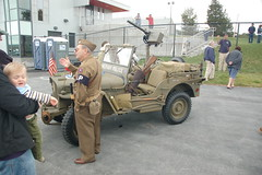 Retired MP veteran telling visitors about his 1943 Willys Jeep (Chris Devers) Tags: plane airplane ma army airport jeep massachusetts wwii airshow worldwarii ww2 norwood 2009 willys worldwar2 worldwartwo bostonist collings collingsfoundation armyjeep wingsoffreedom norwoodma universalhub willysjeep cameranikond50 wingsoffreedomtour exif:exposure_bias=0ev exif:focal_length=18mm exif:exposure=0008sec1125 exif:aperture=f35 lens18200vr camera:make=nikoncorporation exif:flash=offdidnotfire camera:model=nikond50 meta:exif=1257921365 exif:orientation=horizontalnormal exif:lens=18200mmf3556 exif:filename=dscjpg exif:shutter_count=36001 exif:vari_program=portrait meta:exif=1350401304