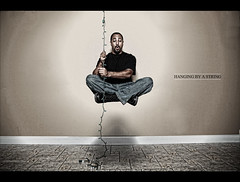 271/365 - HANGING BY A STRING (Arieseffects) Tags: november portrait me self levitation christmaslights 365 2009 marcelle floatation holdingon tdm creativelighting strobist canon5dmarkii 45umbrella grizzelle flashpointmonolight hangingbyastringoflights