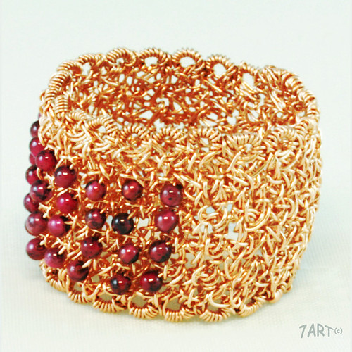rose gold wire crochet ring with garnets