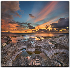 Motivation Lost...  (and then found it in my sock drawer months later) (Ryan Eng) Tags: ocean sunset sea beach colors reflections hawaii rocks oahu northshore tidepools dri sharkscove sigma1020mm nikond90 ryaneng