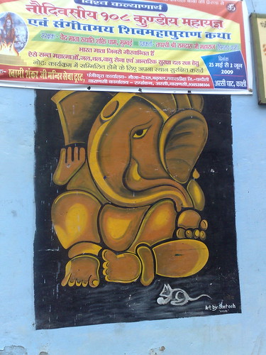 graffit of Ganesha, the Hindu Elephant God, beneath a Hindi banner...