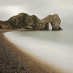 Seahorse (Andy Brown (mrbuk1)) Tags: ocean longexposure sea mist seascape beach rock coast arch shingle shoreline pebbles erosion coastal shore dorset geology tidal lulworth abigfave theonlydifferencebetweenseahorseandseashoreisamisplaceds