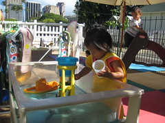 Aki loved the water table at school