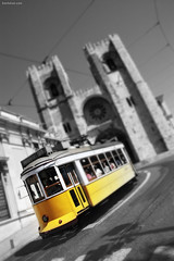 Tram 28 (Ben Heine) Tags: city urban blur building art portugal church public yellow architecture speed jaune skeleton photography town focus downtown quiet oldstyle dof pov pavement lisboa lisbon quality famous cit hill capital curves transport pass citylife tram ciudad blurred nikond70s cathdrale harmony transportation shutter rails electricity dizzy blink distance rue glise tramway pente emptiness ville stad flou colline oldfashioned batiment lisbonne zag highres virage tournant tram28 madeinportugal flickrsbest selectivecolors benheine hubertlebizay hubzay traditionaltram