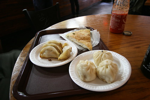 The famous dumplings flanked by pork buns and sesame pancake.