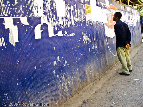 An Ethiopian man checks out the latest bulletins on a public wall in Addis Ababa..
